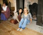 Warming ourselves Konnie Huq, presenter of BBC's Blue Peter and Ellen Harpham warming themselves by the fire after a walk in the rain at Lodge Park, Gloucestershire.
