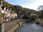 Castle Combe The river running through Castle Combe.  This row of cottages has appeared in many TV programs and films including Dr. Dolittle.