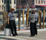 Standing around Three gondoliers chatting in the early morning sun